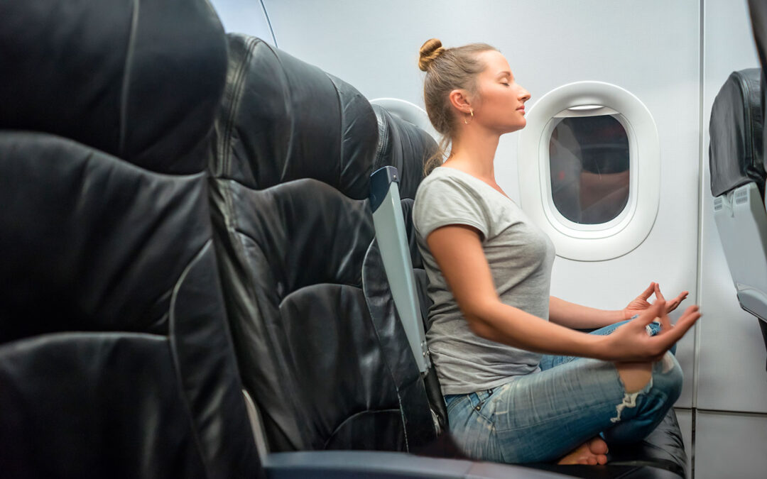 Yoga Poses to Practice in an Airplane Seat